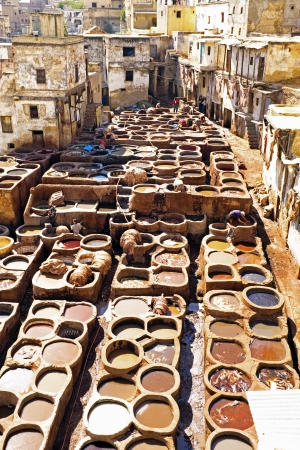 smells: Tanners working leather in the old tannery of Fes, Morocco Editorial