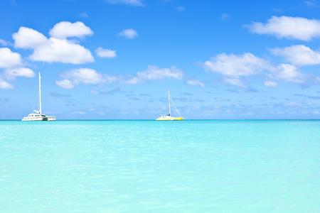 Sail yachts in a blue caribean sea photo