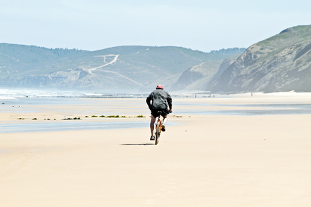 Biker at the beach photo