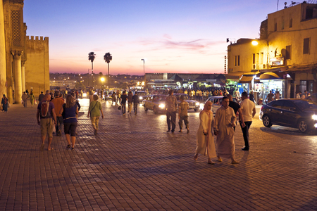 bab: FES. MOROCCO - OCTOBER 15: Bab Boujelud Gate to the old medina in Fes at twilight in Fes, Morocco, Africa Editorial
