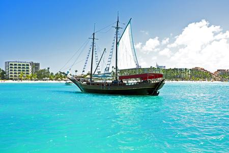 sailingboat: Sailingboat anchoring in the Caribbean