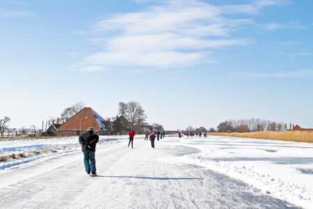 typically dutch: Ice skating in the countyside from the Netherlands