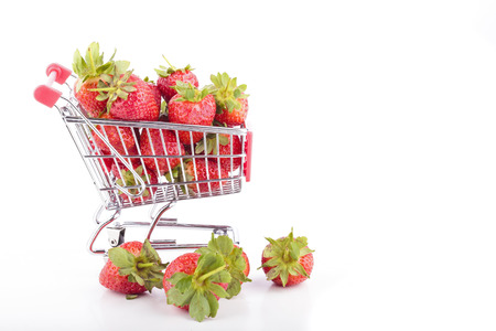 Fresh strawberries in a supermarket cart photo