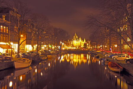 City scenic from Amsterdam with the Waag building in the Netherlands by night photo