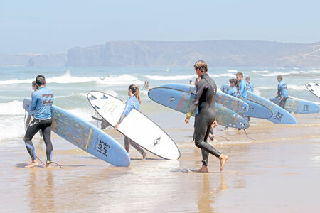 surfers: VALE FIGUEIRAS, PORTUGAL - August 20 2014:  Surfers getting surf classes on the famous surfers beach Vale Figueiras in Portugal