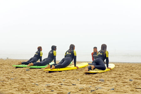 VALE FIGUEIRAS, PORTUGAL - August 9 2014:  Surfers getting surfers lessons on the famous surfers beach Vale Figueiras in Portugal