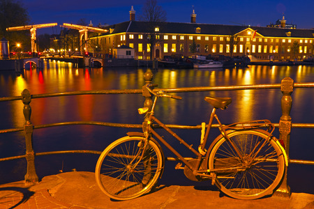 amstel: City scenic from Amsterdam in the Netherlands at the river Amstel at twilight