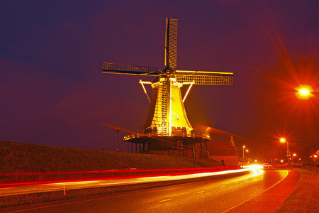 traditional windmill: Traditional windmill in the countryside at night in the Netherlands Stock Photo