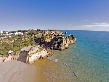 praia: Aerial from rocks and ocean at Praia tres Irmaos in Algarve Portugal Stock Photo