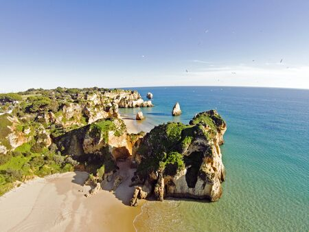 tres: Aerial from rocks and ocean at Praia tres Irmaos in Algarve Portugal Stock Photo