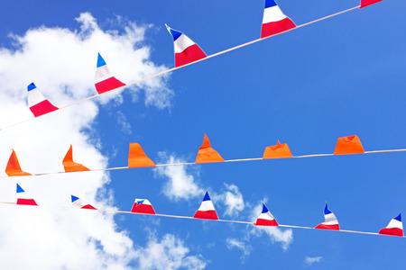 Orange flags celebrating kings day in the Netherlands Foto de archivo