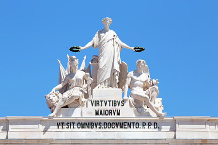 valor: Statues at the top of Rua Augusta Arch in Lisbon Portugal. Allegory of Glory rewarding Valor and Genius.