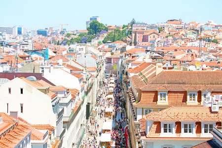 permanently: Aerial view of the Augusta Street and the Downtown District, known as Baixa. The most cosmopolitan street of the city is permanently full with Lisboans and tourists Stock Photo