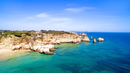 tres: Aerial from natural rocks at Praia Tres Irmaos near Alvor in Portugal