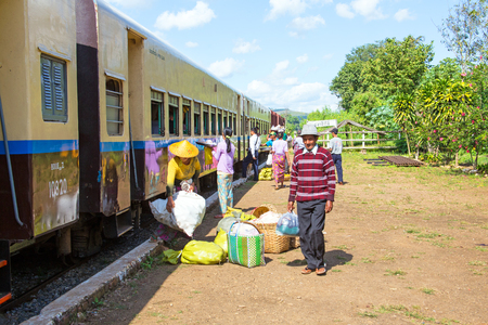 goodies: BAGO, MYANMAR - November 16, 2015: Hawkers selling goodies. Trains in lower Myanmar are little communities of their own with hawkers selling everything imaginable.
