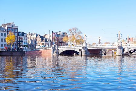 amstel: City scenic from Amsterdam at the Amstel with the Blue Bridge in the Netherlands Stock Photo