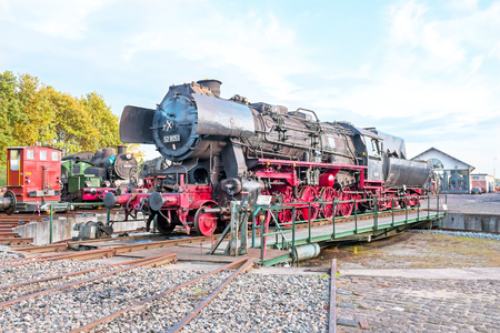 steam locomotive: Antique steam locomotive in depot Editorial