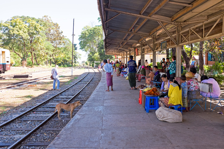 goodies: BAGO, MYANMAR - November 15, 2015: Hawkers selling goodies at the trainstation. Trains in lower Myanmar are little communities of their own with hawkers selling everything imaginable.