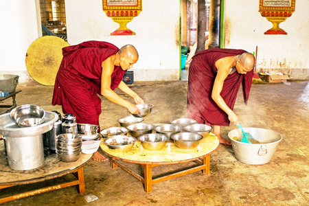 practised: BAGO, MYANMAR -November 26, 2015: Monks preparing lunch in the monastery at Bago Myanmar. Buddhism in Myanmar is predominantly of the Theravada tradition, practised by 89% of the countrys population