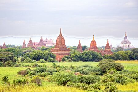 Ancient pagodas in the countryside from Bagan in Myanmar 스톡 콘텐츠