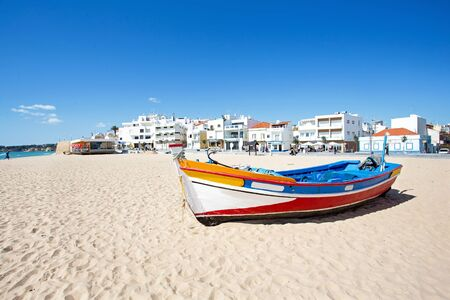 armacao: Fisher boat at the beach in Armacao de Pera in Portugal