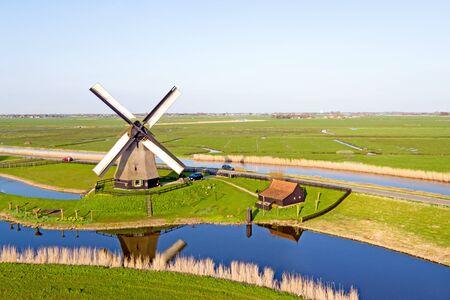 traditional windmill: Traditional windmill in a dutch landscape Stock Photo