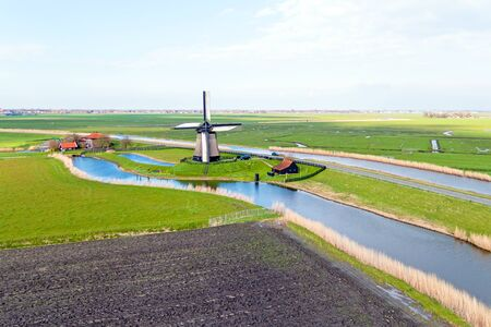 traditional windmill: Traditional windmill in a dutch landscape in the Netherlands Stock Photo