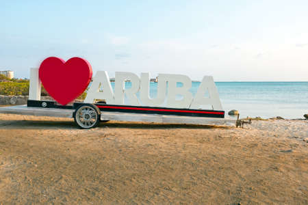 highway love: PALM BEACH, ARUBA - APRIL 14, 2016 - Since the I Love Aruba sign was erected, it has become one of the most photographed landmarks on the island Stock Photo