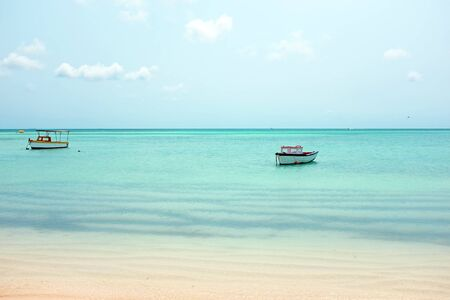 ocean fishing: Little old fishing boats at Aruba island in the Caribbean sea
