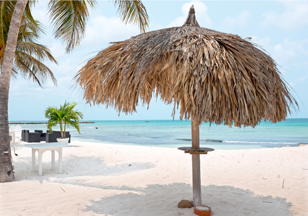 aruba: Grass umbrella at the beach on Aruba island Stock Photo