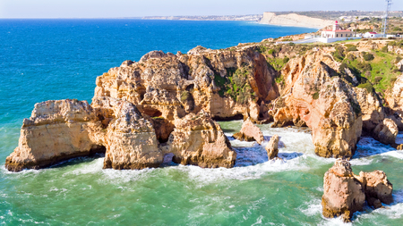 ponte: Aerial from Ponte Piedade with the Lighthouse in Lagos Portugal