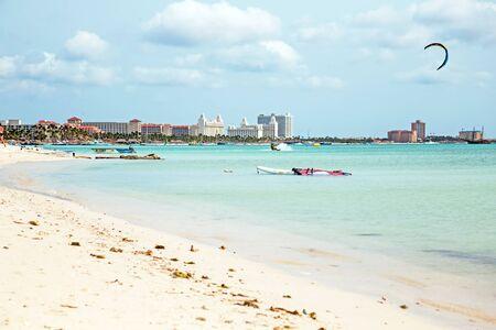 kite surfing: Kite surfing on Palm Beach on Aruba island in the Caribbean Sea Stock Photo