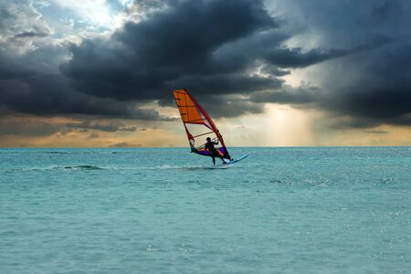 Windsurfer at Aruba island on the Caribbean Sea at a beautiful sunset
