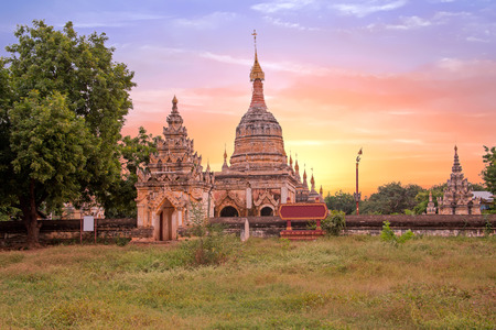 Ancient pagodas in the landscape from Bagan in Myanmar at sunset Stock Photo