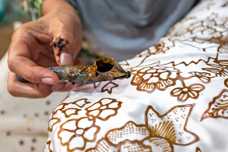 Watercolor painting on the fabric to make Batik. Batik-making is part of Indonesian culture