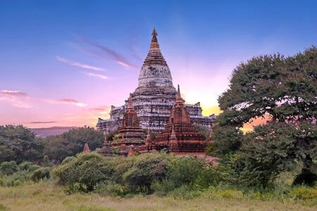 sight seeing: Ancient pagodas in the countryside from Bagan in Myanmar at sunset Stock Photo