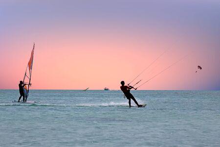 aruba: Water sports on the Caribbean Sea at Aruba island at sunset Stock Photo