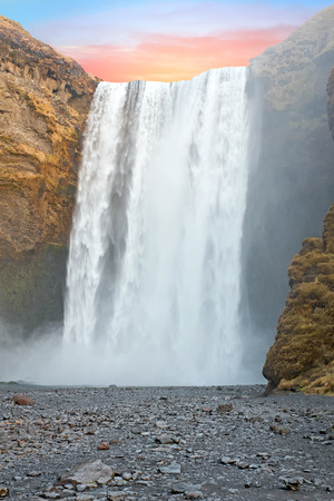Waterfall Skogafoss in Iceland at sunset