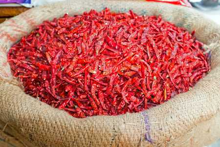 Red hot chili peppers in a jute bag on the market in India