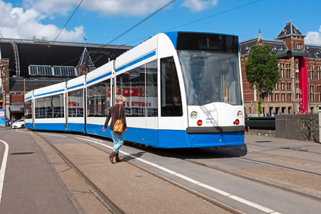 Tram arriving at Central Station in Amsterdam the Netherlands
