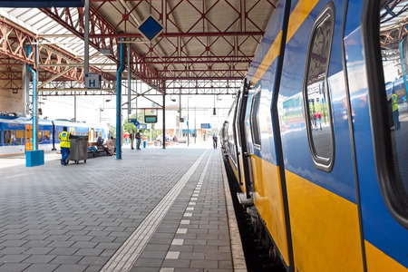 Train departing from Eindhoven station in the Netherlands Stock Photo