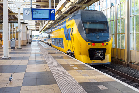 Train departing from Amstel station in Amsterdam the Netherlands Stock Photo - 80897658