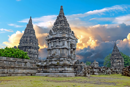 Prambanan or Candi Rara Jonggrang is a Hindu temple compound in Java, Indonesia, dedicated to the Trimurti: the Creator (Brahma), the Preserver (Vishnu) and the Destroyer (Shiva) at sunset Editorial