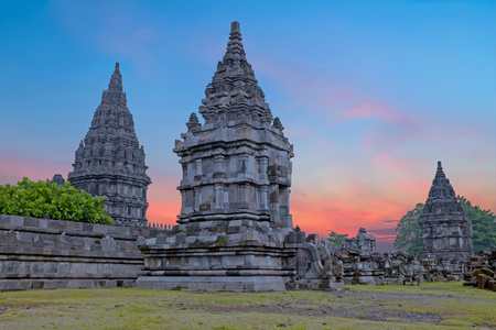 Prambanan or Candi Rara Jonggrang is a Hindu temple compound in Java, Indonesia, dedicated to the Trimurti: the Creator (Brahma), the Preserver (Vishnu) and the Destroyer (Shiva) at sunset Stock Photo