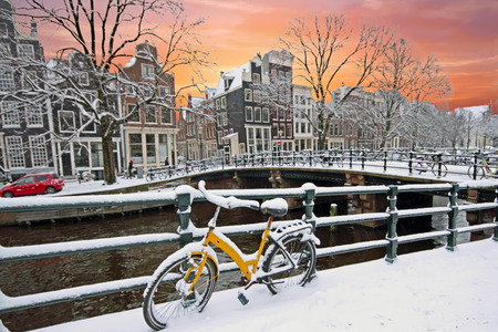Sunset in snowy Amsterdam in the Netherlands at the Amstel in winter Stock Photo