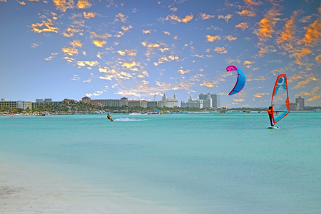 View on Palm Beach at Aruba island in the Caribbean Sea at sunset Stock Photo
