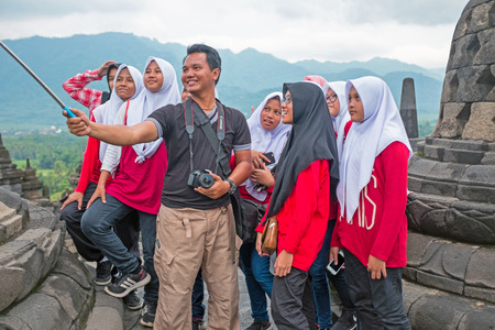 JAVA, INDONESIA - DECEMBER 16, 2016: Making a selfie during visiting Prambanan or Candi Rara Jonggrang, a Hindu temple compound in Java, Indonesia, dedicated to the Trimurti: the Creator (Brahma), the Preserver (Vishnu) and the Destroyer (Shiva) on the 16 Editorial