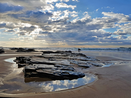 Sun and clouds on Vale Figueiras beach in Portugal Stock Photo