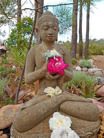 Shiva statue with beautiful flowers Reklamní fotografie