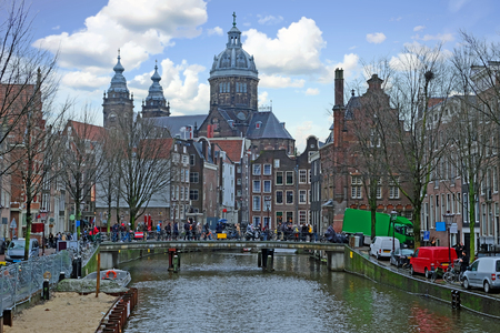 City scenic from Amsterdam in the Netherlands with the Nicolaas church